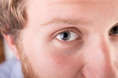 Close up of a man's eye - studio shoot stock vector