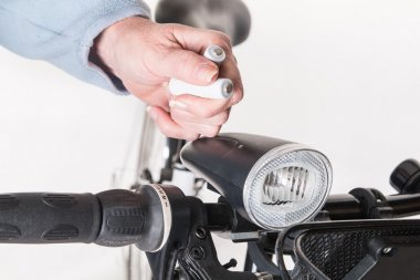 Replace the battery in the front lamp on bicycle wheel