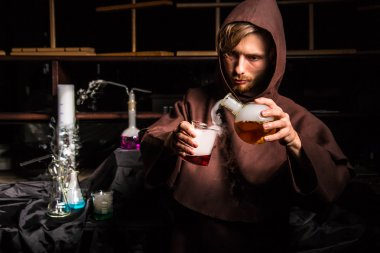 Alchemist in chemical laboratory