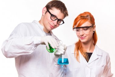 Two chemists with tubes in lab