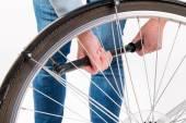 Woman pumping  bicycle wheel