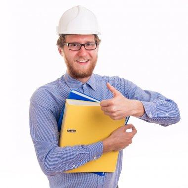 Young happy engineer in helmet