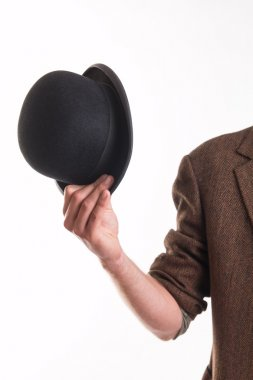 Man holding the old victorian hat