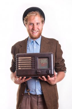 Old-fashioned man holding an old radio