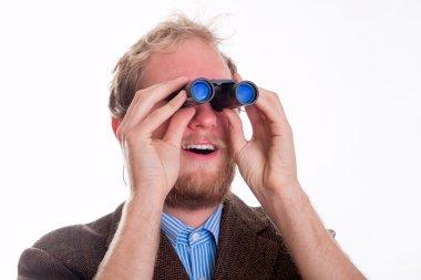 Excited man watching through binoculars - studio shots stock vector