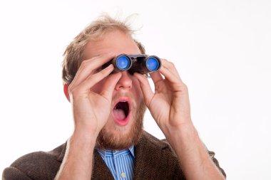 Shocked man watching through binoculars - studio shots stock vector