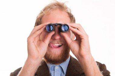 Excited voyeur watching through binoculars - studio shots stock vector