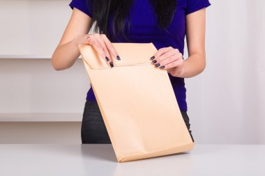 Woman holding  envelope with documents