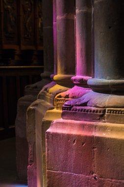 Colored light on pillarsin church