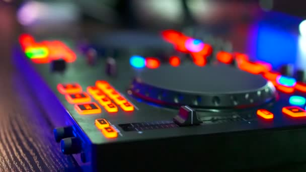 Musical equipment, DJ mixer on table at night club