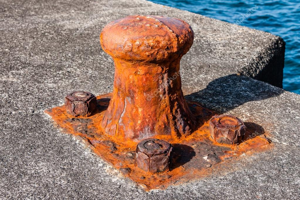 Rusty old bollard on the dock of some harbour in Pico-Azores.
