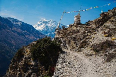 Little Buddhists stone stupa and mantra flags, called lung-ta in Himalayan Mountains