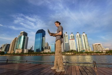 man is  outdoors near business office buildings