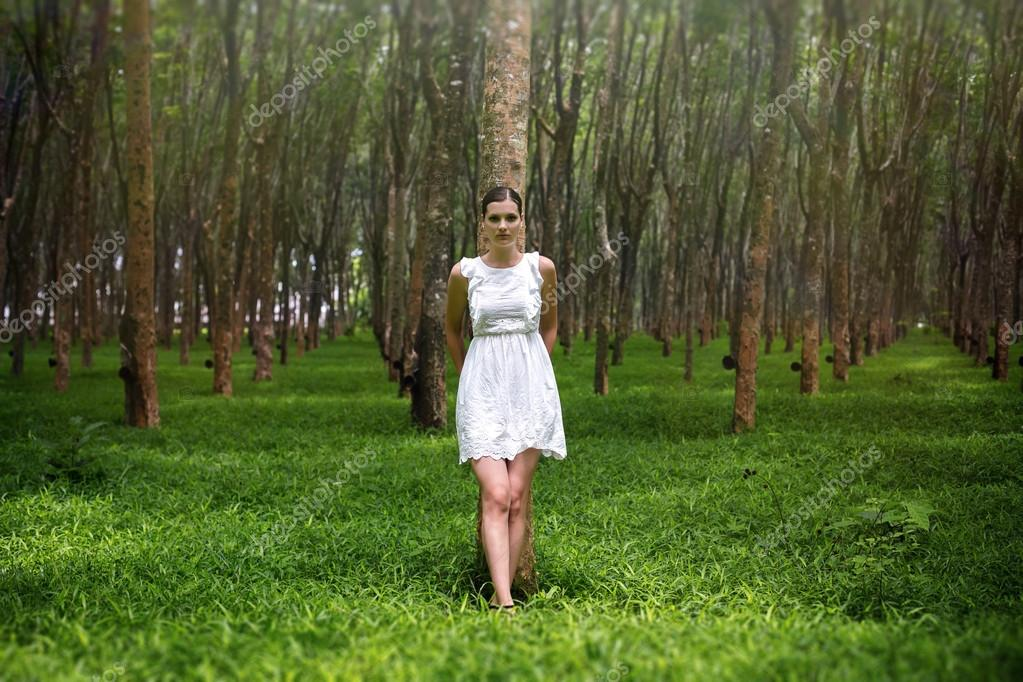 romantic woman in enigmatic forest