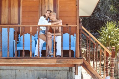 couple in love near wooden house