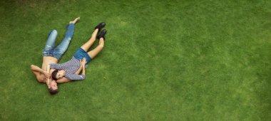 couple lying in a meadow