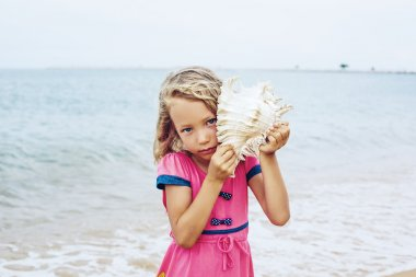 Little girl on the sea