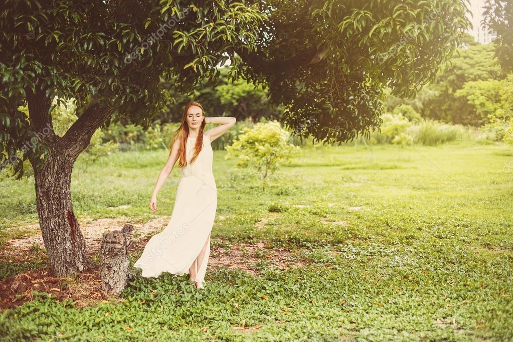woman on green meadow