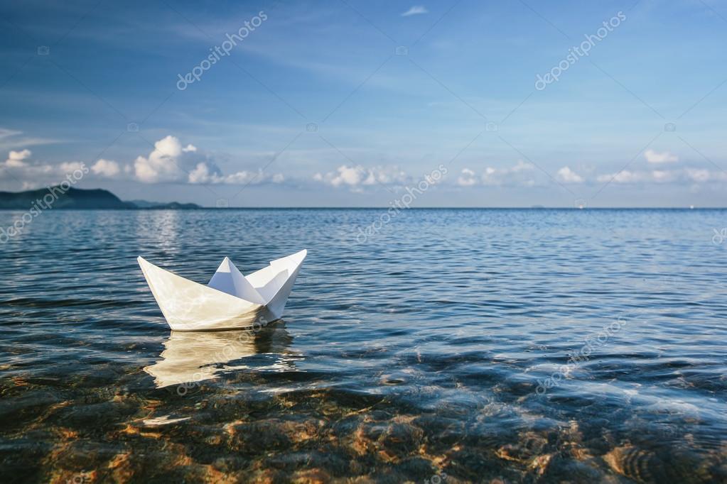 Paper boat in sea