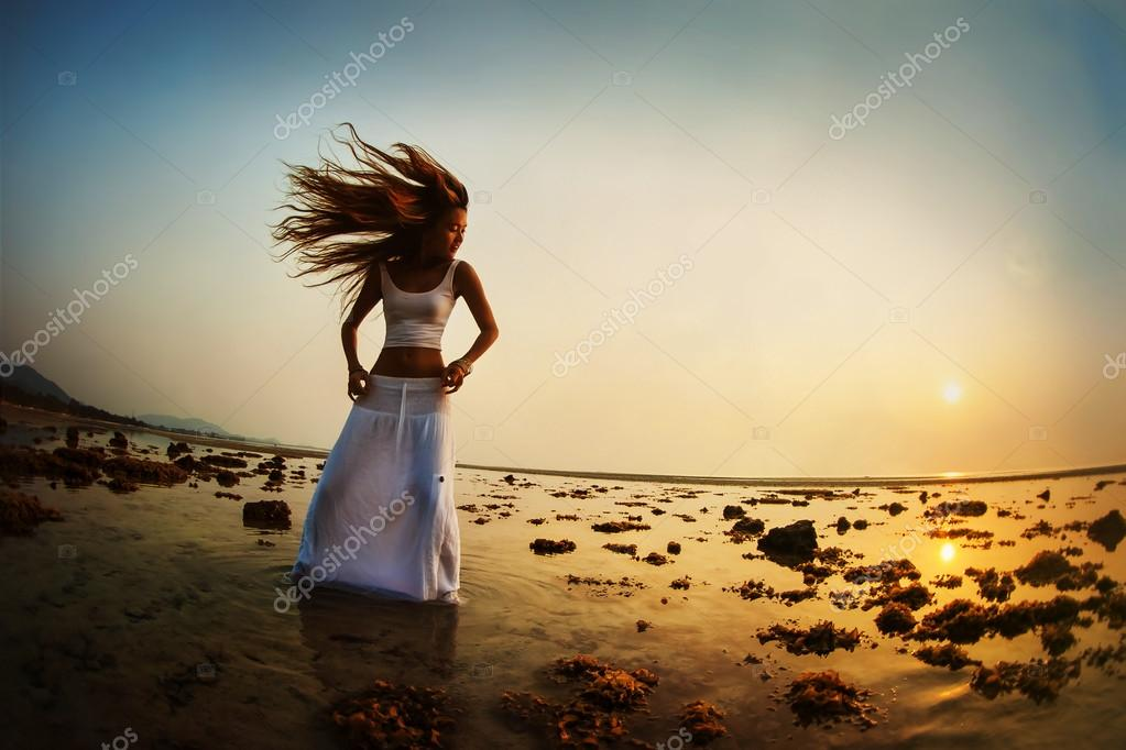 Dancing silhouette of girl at sunset