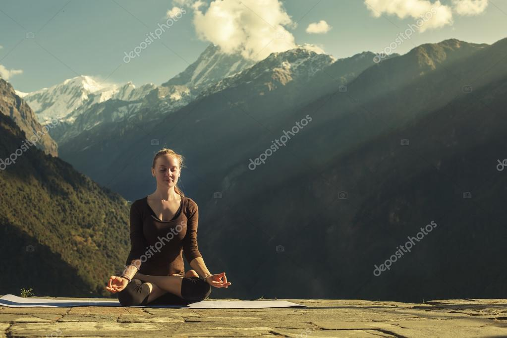 Young Female doing yoga meditation outdoor