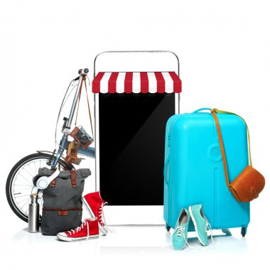The blue suitcase, sneakers, clothing, hat, and phone on white background.