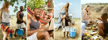 Genç, çok ırklı uluslararası romantik çift güneşli yaz gününde çayırda. Afro-Amerikalı erkek ve beyaz kadın birlikte piknik yapıyorlar. İlişki kavramı, yaz mevsimi.