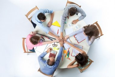 Top view. United hands of business team on workspace background