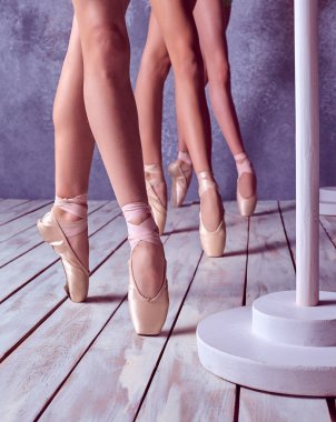 The feet of a young ballerinas in pointe shoes