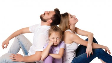 The tired family sitting on white background