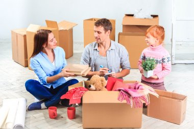 The happy family  at repair and relocation