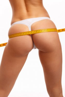young woman measure her buttocks