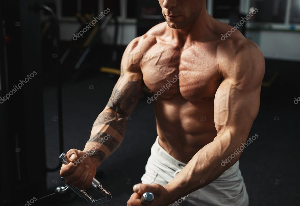 strong bodybuilder doing exercise in the gym