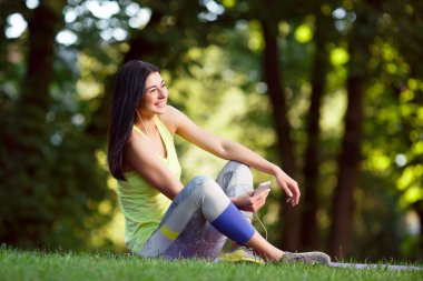 athletic woman resting after exercise