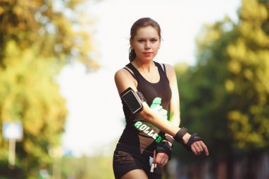woman in black sportswear roller skating