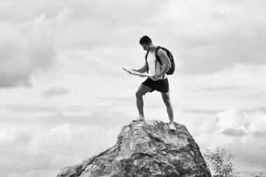 Black and white photo of a tourist with backpack
