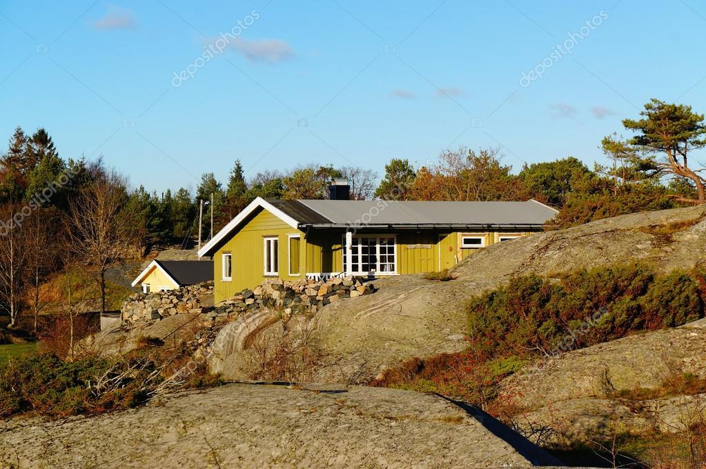 Green cottage hidden between the rocks