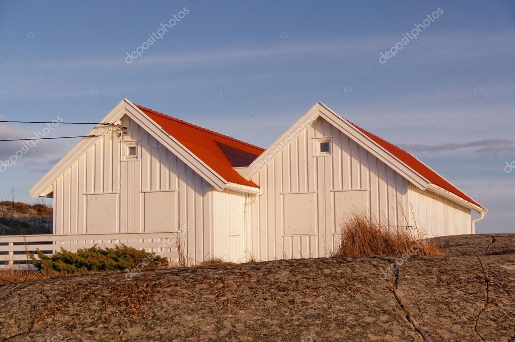 White wooden summer with red roofs