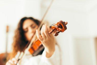 Girl playing violin.