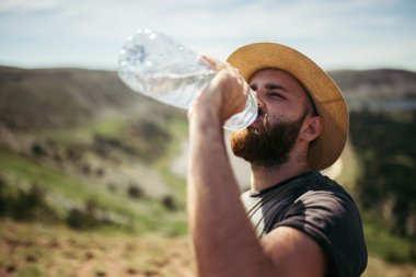 Man drinking water in nature