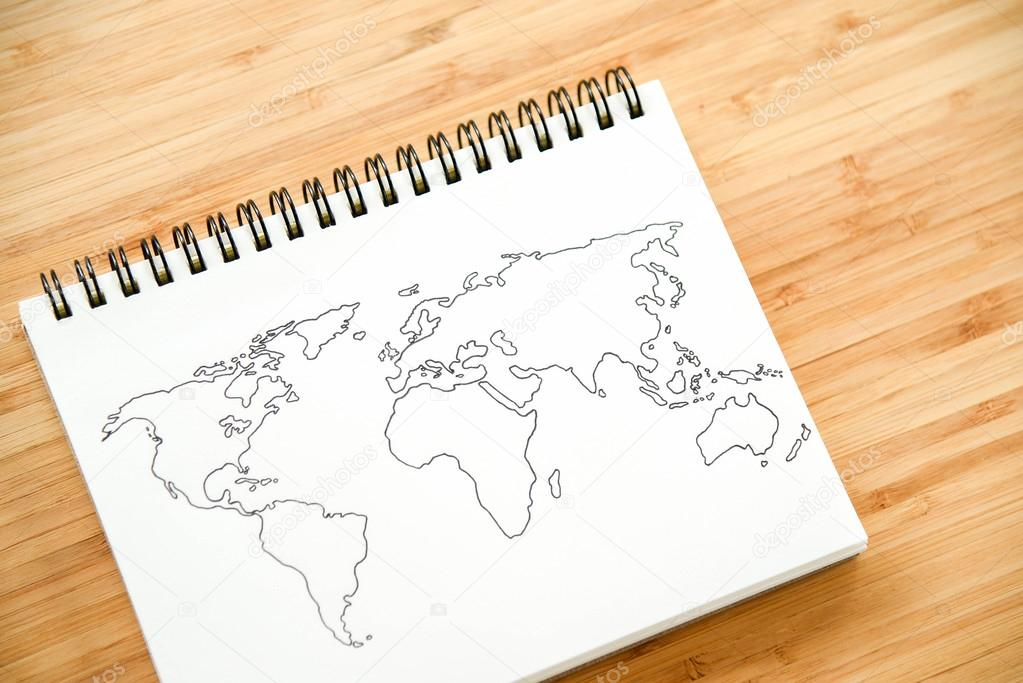 World map outline on notebook stock photo zephyr18 118865694 world map outline sketch on paper of binder notebook that placed on wooden floor background can use for travel business or save the earth concepts photo gumiabroncs Images