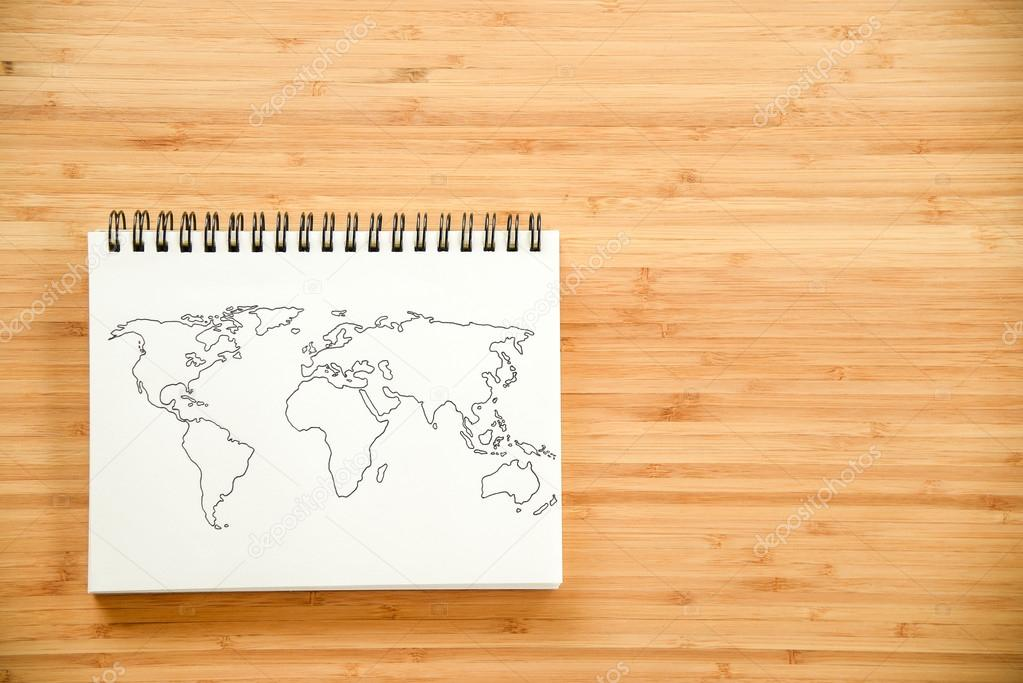 Contorno del mapa de mundo en notebook foto de stock zephyr18 world map outline sketch on paper of binder notebook that placed on wooden floor background can use for travel business or save the earth concepts foto gumiabroncs Gallery