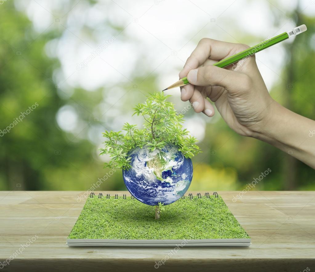 Ruka S Kresba Tuzkou Planety A Strom Z Otevrene Knihy Na Wo Stock
