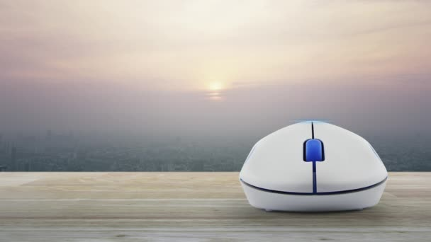 Play movie button with wireless computer mouse on wooden table over modern city tower and skyscraper at sunset sky, vintage style, Business cinema online concept