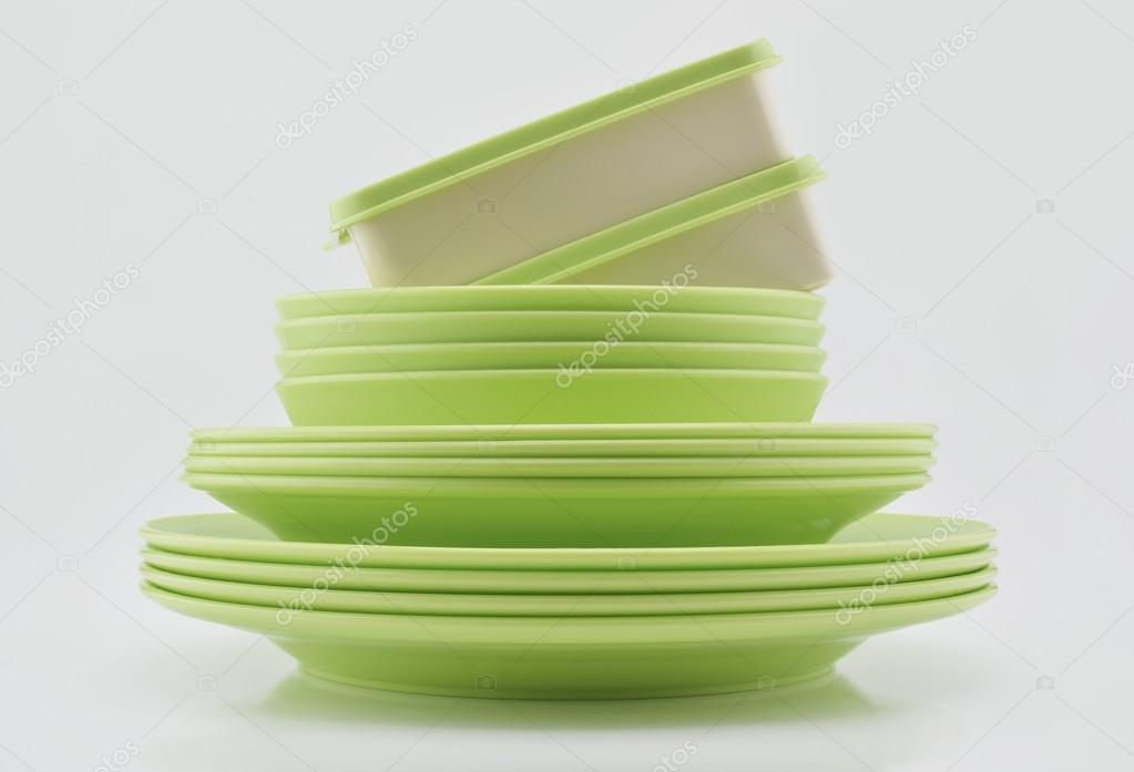 Green plastic plates bowls and boxes isolated on white backgrou \u2014 Stock Photo & Green plastic plates bowls and boxes isolated on white backgrou ...