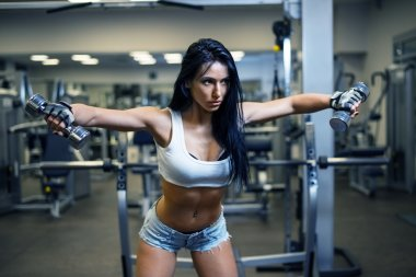 Young sexy girl in a sports gym