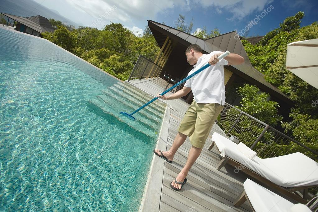 Swimming pool cleaner, professional cleaning service at work.