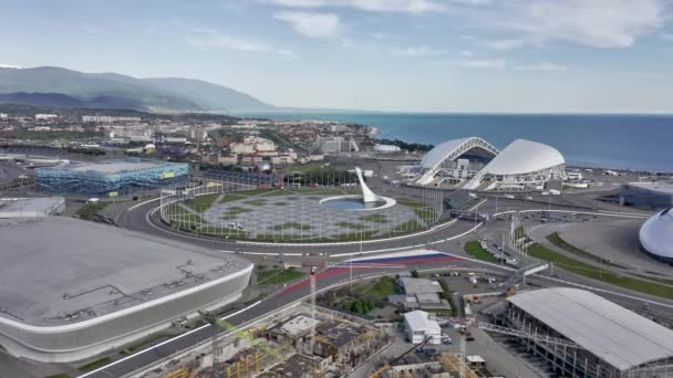 Sochi, Russia - 2021: Olympic flame, flags and Fisht ...