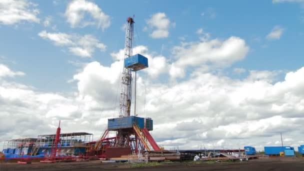 4K Timelapse clouds over drilling rig