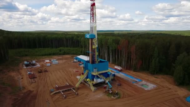 the oil gas drilling tower in forest